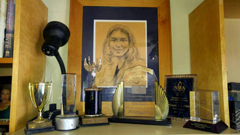 Olympia LePoint - image of awards on shelf